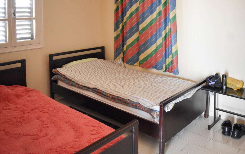 Спальня в апартаментах на продажу